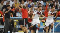 Pria berdarah Turki ini melakoni debut bersama timnas Jerman pada 2009. Hiingga Piala Dunia 2018, ia telah tampil 92 kali dan mencetak 23 gol. (AFP/Odd Andersen)