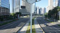 Suasana Jalan MH Thamrin dan Jalan Sudirman di Jakarta, Minggu (24/5/2020). Berbeda dengan hari biasa, kedua jalan protokol tersebut tampak lebih lengang akibat diberlakukannya PSBB yang juga bersamaan dengan Hari Raya Idul Fitri 1441 H. (Liputan6.com/Immanuel Antonius)