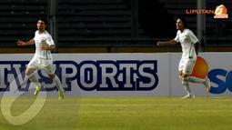 Hammadi Ahmed Abdullah (Irak - 7) melakukan selebrasi usai mencetak gol ke gawang Indonesia dalam laga kualifikasi Piala Asia 2015 (Liputan6.com/Helmi Fithriansyah)