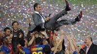 Pep Guardiola kini menjadi satu dari beberapa pelatih yang layak berada di level terbaik di era sepak bola modern. Barcelona, Bayern Munchen, dan Manchester City telah dibawanya mengangkat trofi juara. (Foto: AFP/Lluis Gene)