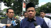 Fahri Hamzah mendatangi Polda Metro Jaya untuk diperiksa sebagai pelapor (Merdeka.com/Ronald)