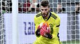 De Gea kembali dipercaya oleh Solskjaer menjadi starter saat melawan AS Roma di dini hari tadi. Sang kiper bisa dikatakan menjadi pahlawan Manchester United di laga itu. (Foto: AFP/Filippo Monteforte)