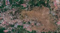Citra satelit 1 Oktober 2018 yang disediakan oleh DigitalGlobe ini menunjukkan lingkungan Petobo di Palu, Indonesia, setelah gempa bumi dan tsunami berikutnya menyebabkan kerusakan dan likuifaksi yang besar di desa. (DigitalGlobe, perusahaan Maxar via AP)