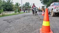 Jalan Poros Trans Batumarta Unit 2, Kecamatan Lubuk Raja, Kabupaten Ogan Komering Ulu (OKU), Sumatera Selatan. (Dok Kementerian PUPR)