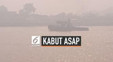 Kabut asap dari kebakaran hutan dan lahan, mulai berdampak bagi aktivitas warga Pontianak, Kalimantan Barat pada Jumat (6/9/2019) pagi.