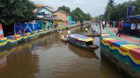 Kampung Mural Sekanak Bersolek menjadi salah satu destinasi baru di kota Palembang (Liputan6.com / Nefri Inge)