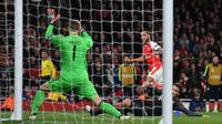 Theo Walcott tetap puji Arsenal meski dibantai Muenchen (Ben STANSALL / AFP)