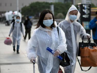 FOTO: Penampilan Berbeda Warga Wuhan Setelah Corona Mereda