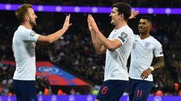 Harry Kane terus menunjukan performa yang stabil bersama Timnas Inggris. (AFP/Glyn Kirk)