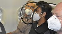 Perusahaan Desain Kenalkan Alat Penghalang Virus dan Modus di Bangku Pesawat. (dok.Twitter @RunwayGirl/https://twitter.com/RunwayGirl/status/1271176486154915847/Henry)