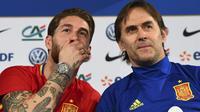 Julen Lopetegui (kanan) yakin winger muda Gerard Deulofeu bakal berkontribusi banyak pada kemenangan tim di masa mendatang. . (FRANCK FIFE / AFP)