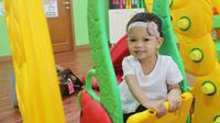 Ibu pekerja yang menitipkan anaknya di Tempat Penitipan Anak atau Taman Pengasuhan Anak (TPA) kantor berpotensi naik jabatan. (Liputan6.com/Fitri Haryanti Harsono)