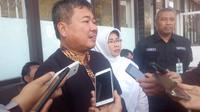 Bupati Garut Rudy Gunawan saat penyambutan korban gempa Donggala-Palu di Garut (Liputan6.com/Jayadi Supriadin)