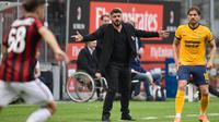 Ekspresi pelatih AC Milan, Gennaro Gattuso saat memimpin timnya melawan Hellas Verona pada lanjutan Serie A di San Siro stadium, Milan, (5/5/2018). AC Milan menang telak 4-1. (AFP/Miguel Medina)