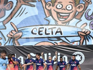 Juara bertahan Liga Spanyol, Atletico Madrid, mengawali kampanye mereka di La Liga 2021/2022 dengan kemenangan tandang. Bertandang ke markas Celta Vigo pada pekan pembuka, pasukan Diego Simeone menang dengan skor 2-1. (Foto: AFP/Miguel Riopa)