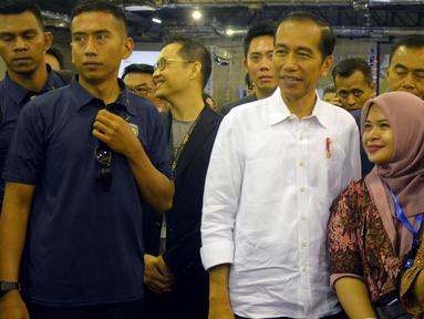 """Presiden Joko Widodo saat menghadiri acara bertajuk """"Young On Top NationalConference (YOTCN) di Balai Kartini, Jakarta, Sabtu (25/8). Acara ini dihadiri sebagian besar anak muda. (Liputan6.com/Pool/Ist)"""
