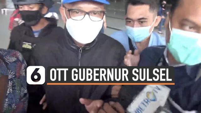 Gubernur Sulawesi Selatan Nurdin Abdullah digiring petugas KPK di bandara Soekarno Hatta Sabtu (27/2) pagi. Sebelumnya, ia kena OTT KPK bersama sejumlah orang lainnya di sebuah rumah makan.