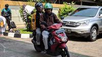 Suasana proses migrasi dan rekrutmen sopir Uber ke GrabBike di GOR Bendungan Hilir, Jakarta Pusat. Liputan6.com/Jeko. I.R