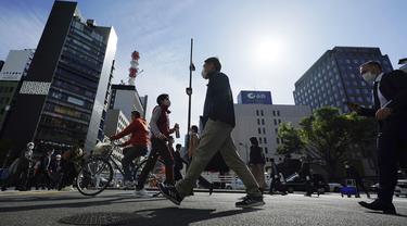 FOTO: Tokyo Konfirmasi Lebih dari 700 Kasus Baru COVID-19