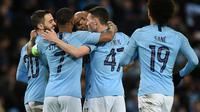 Para pemain Manchester City merayakan gol ke gawang Schalke pada laga Liga Champions. (AFP/Oli Scarff)