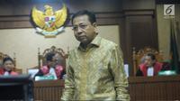 Terdakwa dugaan korupsi proyek e-KTP, Setya Novanto bersiap memberi kesaksian pada sidang lanjutan di Pengadilan Tipikor, Jakarta, Kamis (22/3). Sidang mendengar kesaksian terdakwa. (Liputan6.com/Helmi Fithriansyah)