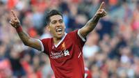 Pemain Liverpool, Roberto Firmino merayakan golnya ke gawang AFC Bournemouth pada lanjutan Premier League di Anfield stadium, Liverpool,(14/4/2018). Liverpool menang 3-0.  (AFP/Lindsey Parnaby)