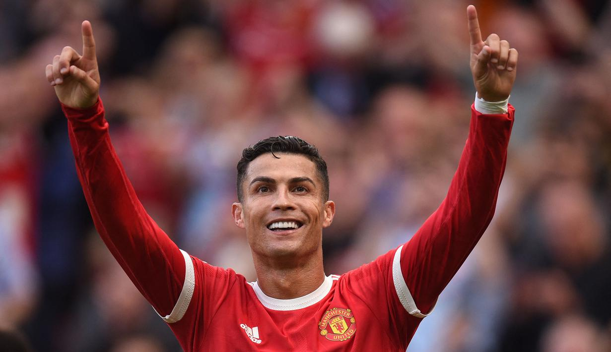 Cristiano Ronaldo langsung memberikan efek luar biasa untuk Manchester United. Tampil perdana pada momen comeback, ia langsung mencetak dua gol saat melibas Newcastle United 4-1. (Foto: AFP/Oli Scarff)