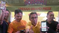 Kementerian Koperasi dan UKM merangkul generasi milenial dengan mendorong penggunaan tabungan online berbasis aplikasi dari KSP Sahabat Mitra Sejati (Liputan6.com/ Switzy Sabandar)