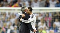 Carlo Ancelotti dan Cristiano Ronaldo saat masih sama-sama di Real Madrid pada 2014. (AFP PHOTO/Javier Soriano)