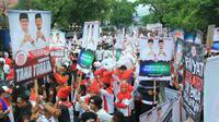 Pendukung bakal calon Gubernur-Wakil Gubernur Sulawesi Selatan, Ichsan Yasin Limpo dan Andi Mudzakkar. (Liputan6.com/Fauzan)
