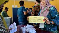 Semua pihak diminta bersabar menunggu pengumuman resmi KPU terkait hasil perhitungan suara Pilkada serentak 2018 (Liputan6.com/Yuliardi Hardjo)