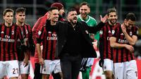 Pelatih AC Milan, Gennaro Gattuso merayakan kemenangan usai mengalahkan Sampdoria 1-0 pada lanjutan Liga Serie A Italia di stadion San Siro (18/2). Il Diavolo Rosso belum terkalahkan dalam 10 laga terakhir di berbagai ajang. (AFP Photo/Miguel Medina)