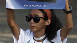 Aktivis menggelar aksi Renungan 10 Tahun Undang-Undang Narkotika di Taman Aspirasi, Monas, Jakarta, Selasa (25/6/2019). Aksi ini juga dalam rangka memperingati Hari Anti Narkotika Internasional. (merdeka.com/Iqbal S Nugroho)