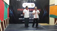 Sesmenpora Gatot S. Dewabroto (kanan) dalam jumpa pers simposium soal Esports, di Jakarta, Kamis (5/9/2019). (Liputan6.com/Luthfie Febrianto)
