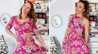 Seorang wanita penggemar fashion vintage mengubah pakaian bekas menjadi lebih stylish dengan cara menjahit ulang.