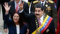 Presiden Venezuela Nicolas Maduro dan istrinya Cilia Flores (AFP Photo/Federico Parra)