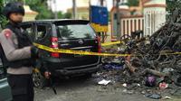 Tumpukan kendaraan yang hancur diterjang bom Surabaya (Merdeka.com/Ahda Bayhaqi)