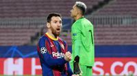 Lionel Messi terus mencetak gol di Liga Champions selama 17 musim beruntun (2005-2021). Selain itu La Pulga juga menorehkan minimal 20 gol untuk musim ke-13 berturut-turut bersama Barcelona. (AFP/Lluis Gene)