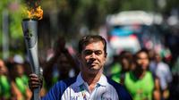 Acara kirab obor di Bali melibatkan dua mantan atlet legendaris Indonesia, Pascal Wimar (Voli) dan Ade Rai (Binaraga) yang bertugas membawa api obor Asian Games 2018.