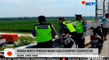 Sebanyak 31 pemudik dari Jakarta diturunkan oleh awak bus antar kota antar provinsi (AKAP), yang mereka tumpangi di jalur Tol Ngawi, Jawa Timur, untuk menghindari penyekatan petugas di pintu tol. Aksi nakal oknum awak bus itu dipergoki warga Desa Nga...