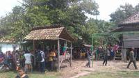 Suasana rumah duka Ibrahim, petani yang tewas diterkam buaya rawa di Kabupaten Banyuasin (Liputan6.com / Nefri Inge)