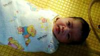 Bayi cantik ini dilahirkan dari ibu yang tak diketahui identitasnya. (Foto: Liputan6.com/Muhamad Ridlo/istimewa)