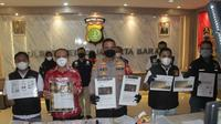 Polres Metro Jakarta Barat mengamankan terduga pelaku penipuan investasi bodong perusahaan bernama Lucky Star. (Liputan6.com/Ady Anugrahadi)