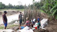 Tanggul Sungai Cimeneng, Bulaksari, Bantarsari, Cilacap, jebol di lima titik. (Foto: Liputan6.com/Muhamad Ridlo)