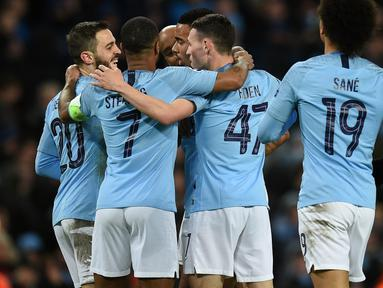 Perayaan gol Man City pada leg kedua, babak 16 besar Liga Champions yang berlangsung di Stadion Etihad, Manchester, Rabu (13/3). Man City menang 7-0 atas Schalke. (AFP/Oli Scarff)