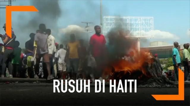 Aksi protes ribuan warga Haiti berujung rusuh, diwarnai aksi pembakaran kendaraan. Satu orang warga dilaporkan tewas.
