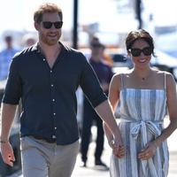 Pangeran Harry dan Meghan Markle di Kingfisher Bay Resort di Fraser Island,Australia,  22 Oktober 2018. (DARREN ENGLAND / POOL / AFP/Asnida Riani)
