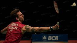 Jan O Jorgensen memang memiliki banyak koleksi tato, yang menurut Badminton World, gambar-gambar itu sudah ada ditubuhnya sejak tahun 2010 dan tiap tahunnya terus bertambah. (Bola.com/Vitalis Yogi Trisna)