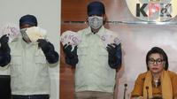 Petugas KPK disaksikan Wakil Ketua KPK Basariah Panjaitan menunjukkan barang bukti uang SGD 96.700 hasil OTT di Gedung KPK, Kamis (1/8/2019). Uang tersebut diduga terkait suap proyek pengadaan baggage handling system (BHS) atau sistem penanganan bandara untuk 6 bandara. (merdeka.com/Dwi Narwoko)