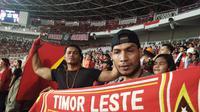 Suporter Timor Leste di Stadion Gelora Bung Karno, Jakarta saat melawan Timnas Indonesia, 13 November 2018. (Foto: Cakrayuri Nuralam/Liputan6.com)